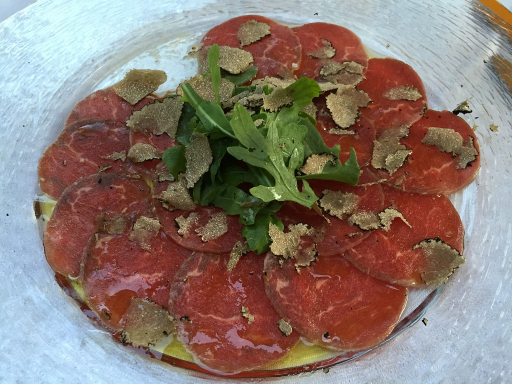 Carpaccio from beef filet, marinated in lemon and olive oil with fresh sliced Burgundertruffles.