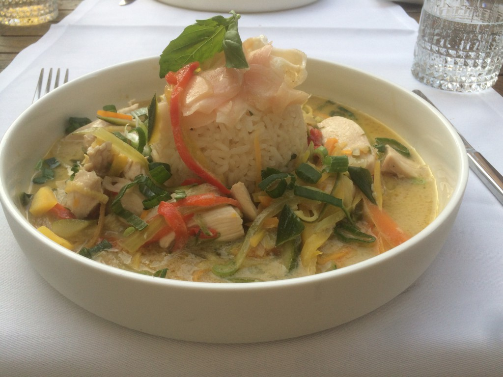 Green Thai curry with pickled ginger, chicken breast slices, asian vegetables and jasmine rice